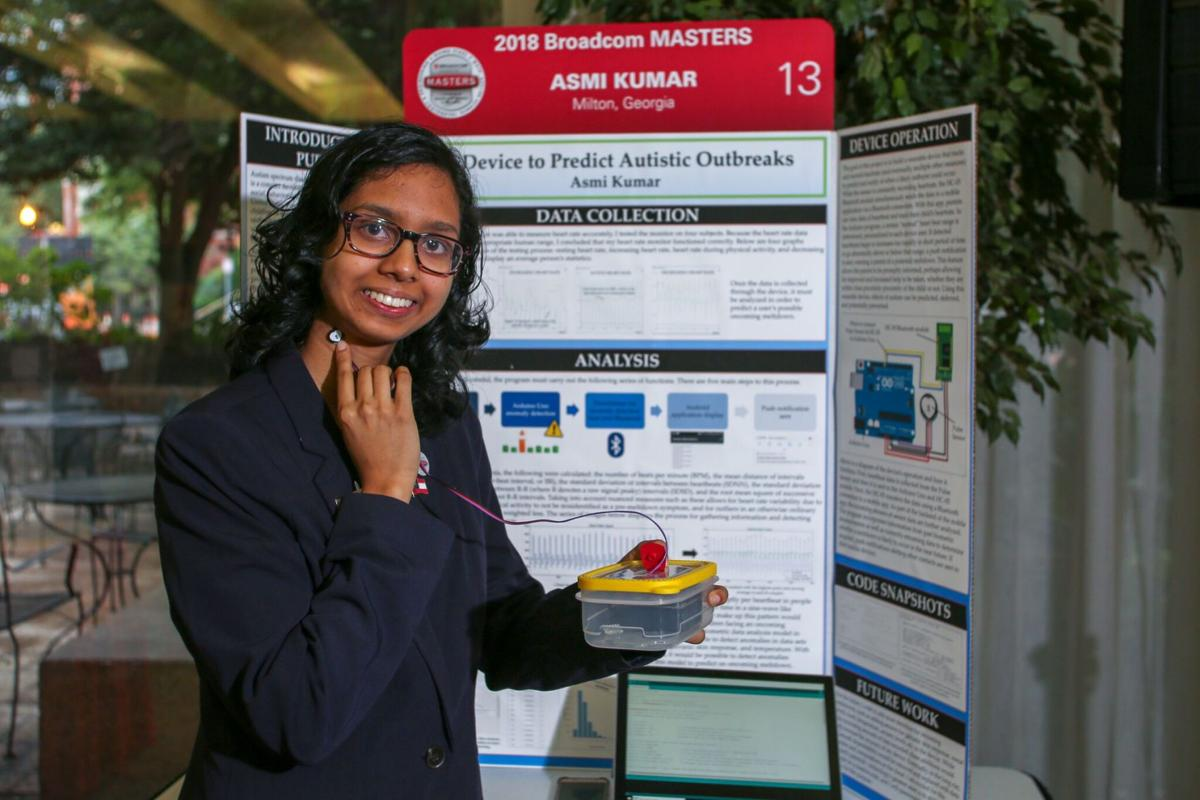 Asmi Kumar demonstrates her project