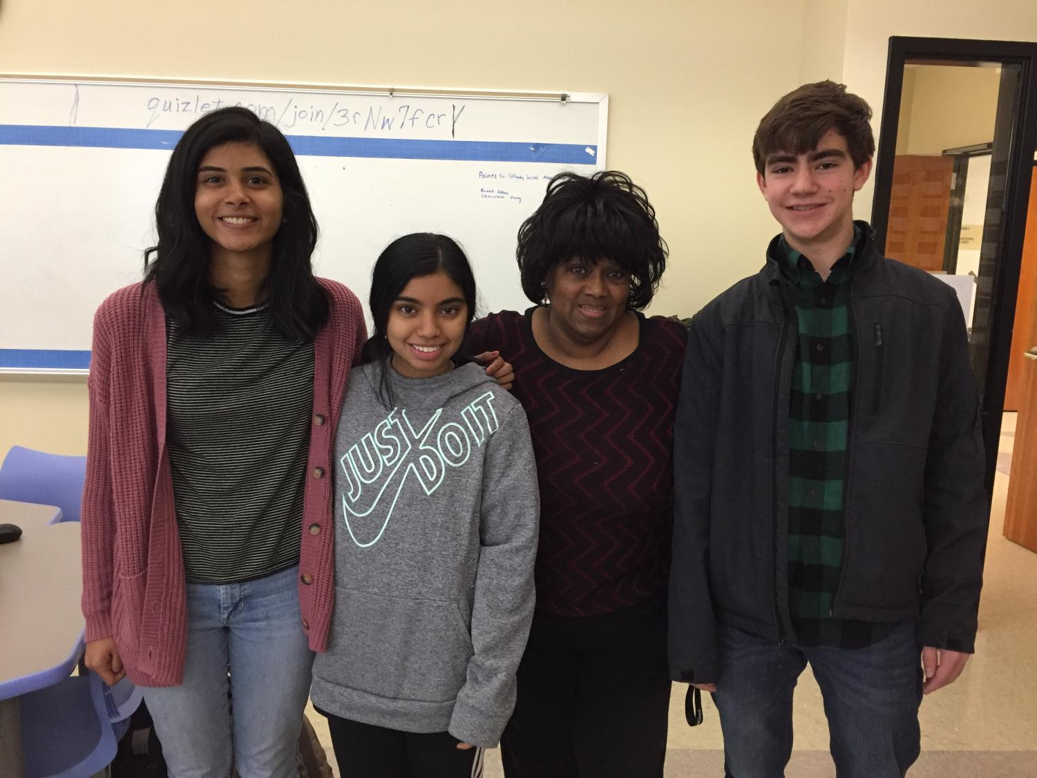 Ms. Upshur with student members of FBLA. From left to right: Angela Scaria, Shruthi Saravanan, Ms. Upshur, and Harrison Iles.